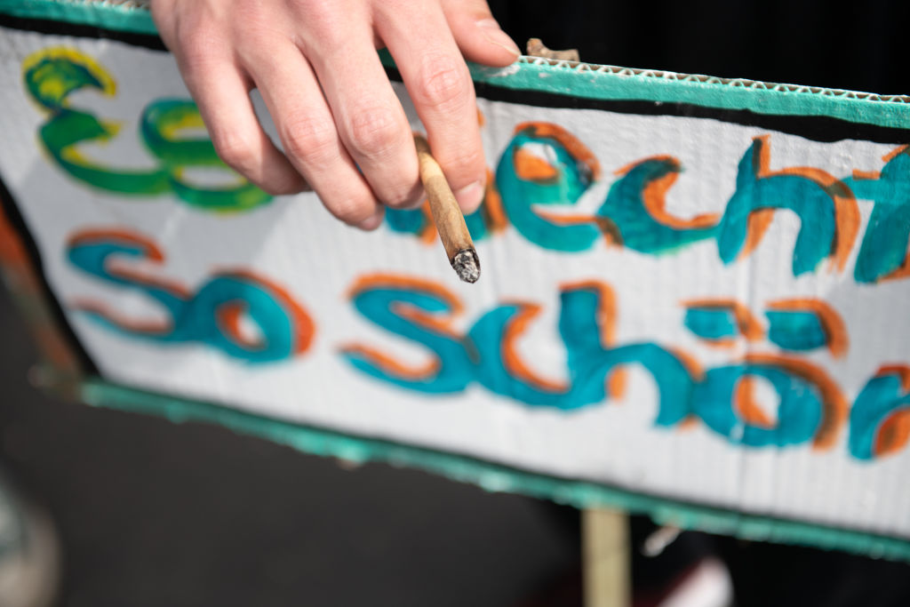 A protestor demanding the legalisation of cannabis smokes a joint in Berlin, Germany.